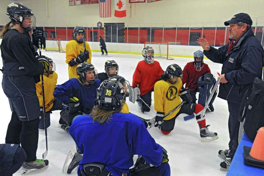 Coach Tom Sheehan talks to his team during an Albany Academy for Girls ice hockey team practice at t