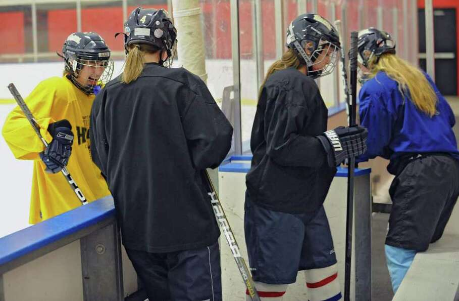 The Albany Academy for Girls ice hockey team leaves the ice after practice at the Albany Academy fie