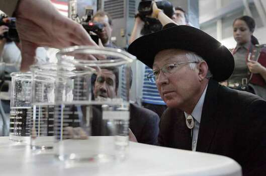 Secretary of the Interior Ken Salazar takes a close look at samples from the Kay Bailey Hutchison Desalination Plant in El Paso, Texas on Wednesday, January 4, 2012 during a tour by desalination plant Superintendent Art Ruiz. Photo: Vanessa M Feldman, Associated Press / The El Paso Times