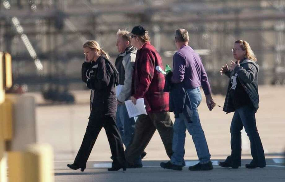 Boeing employees in Wichita, Kan., leave a companywide meeting Wednesday at which the aerospace company announced it would close a plant in the city that employs 2,150 workers. Photo: Travis Heying / The Wichita Eagle