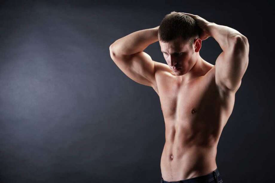 Using body contouring procedures, plastic surgeons can make it appear there is a six-pack on a man who lacks muscle tone, but only if the patient already exercises and eats a healthy diet. Photo: Fotolia / pressmaster - Fotolia