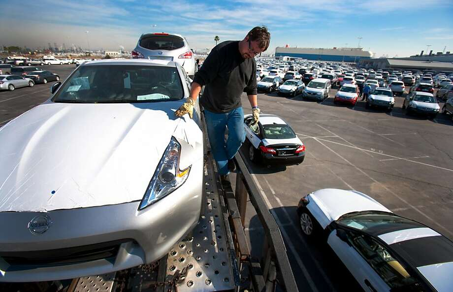 Trucker Don Pinkus of Fontana, California, loads a car carrier truck with Nissan Motor Co. vehicles at the Port of Los Angeles in Wilmington, California, U.S., on Thursday, Dec. 29, 2011. Bloomberg is scheduled to release total vehicle sales numbers on Jan. 4. Photographer: Tim Rue/Bloomberg *** Local Caption *** Don Pinkus Photo: Tim Rue, Bloomberg