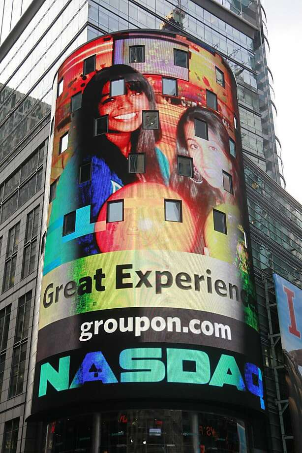 FILE - In this Nov. 4, 2011 file photo, a display for Groupon is shown at the Nasdaq MarketSite, in New York. Groupon had its IPO Friday. On Thursday, the company priced its IPO at $20 per share. That was above its expected range of $16 to $18. It gave Groupon a market value of $12.7 billion, above only Googleís among tech companies.  (AP Photo/Mark Lennihan) Photo: Mark Lennihan, Associated Press