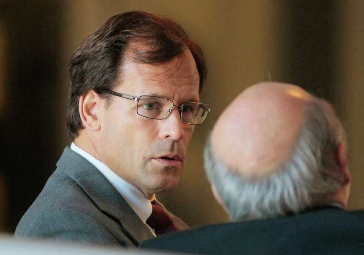 Dr. Steven Chase Brigham speaks with one of his attorneys as he waits to appear before the New Jersey Board of Medical Examiners in 2010. He was accused of violating state regulations on performing late-term abortions. (Tony Kurdzuk / The Star-Ledger)
