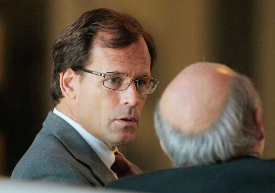 Dr. Steven Chase Brigham speaks with one of his attorneys as he waits to appear before the New Jersey Board of Medical Examiners in 2010. He was accused of violating state regulations on performing late-term abortions. (Tony Kurdzuk / The Star-Ledger) Photo: Kurdzuk, Tony / The Star Ledger