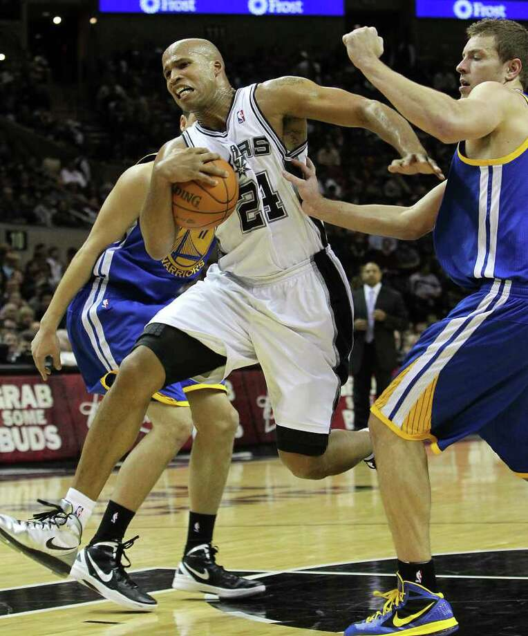 Spurs' Richard Jefferson (24) drives to the basket between Golden State Warriors' Klay Thompson (11) and David Lee (10) in the first half at the AT&T Center on Wednesday, Jan. 4, 2012. Kin Man Hui/kmhui@express-news.net Photo: KIN MAN HUI, Express-News / SAN ANTONIO EXPRESS-NEWS