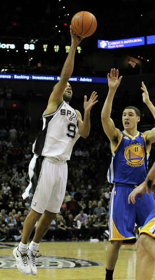 Spurs' Tony Parker (09) pops a floater over Golden State Warriors' Klay Thompson (11) in the second half at the AT&T Center on Wednesday, Jan. 4, 2012. Spurs won 101-95. Kin Man Hui/kmhui@express-news.net Photo: KIN MAN HUI, Express-News / SAN ANTONIO EXPRESS-NEWS