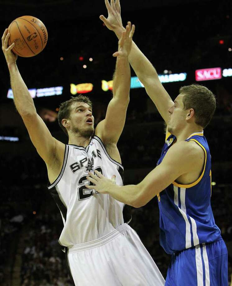 Spurs' Tiago Splitter (left) shoots over Golden State Warriors' David Lee (10) in the second half at the AT&T Center on Wednesday, Jan. 4, 2012. Spurs won 101-95. Kin Man Hui/kmhui@express-news.net Photo: KIN MAN HUI, Express-News / SAN ANTONIO EXPRESS-NEWS