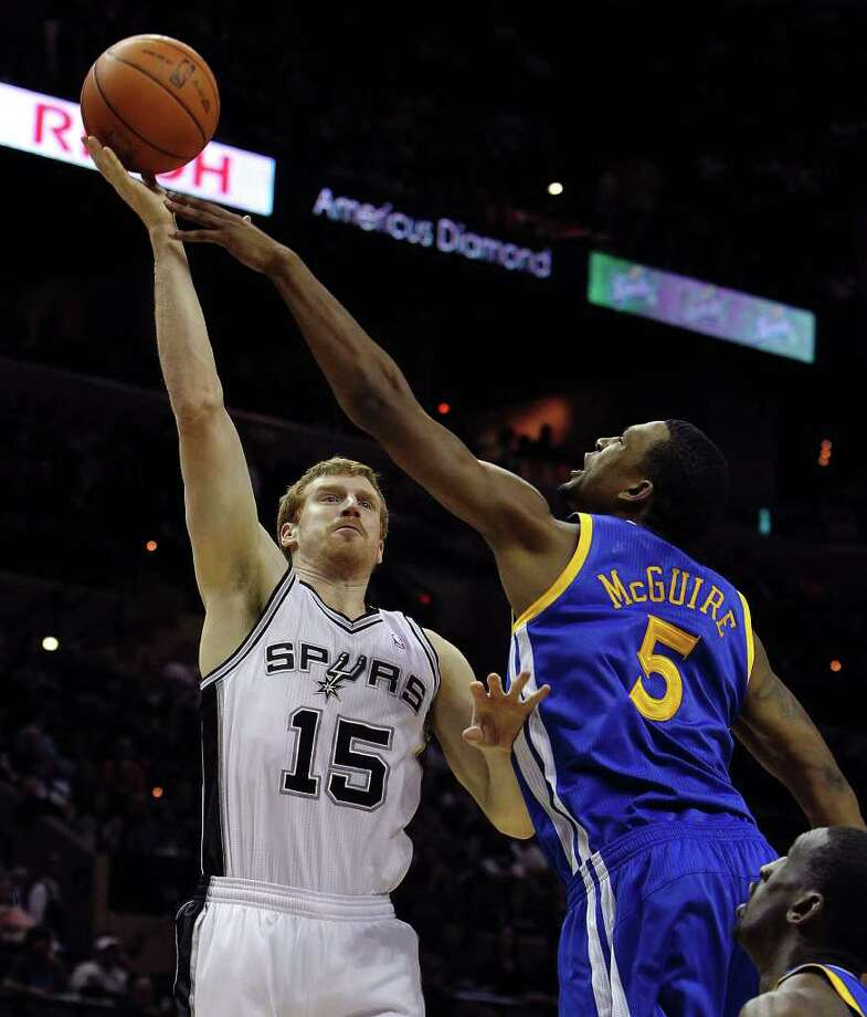 Spurs' Matt Bonner (15) shoots over the Golden State Warriors' Dominic McGuire (05) in the first half at the AT&T Center on Wednesday, Jan. 4, 2012. Kin Man Hui/kmhui@express-news.net Photo: KIN MAN HUI, Express-News / SAN ANTONIO EXPRESS-NEWS