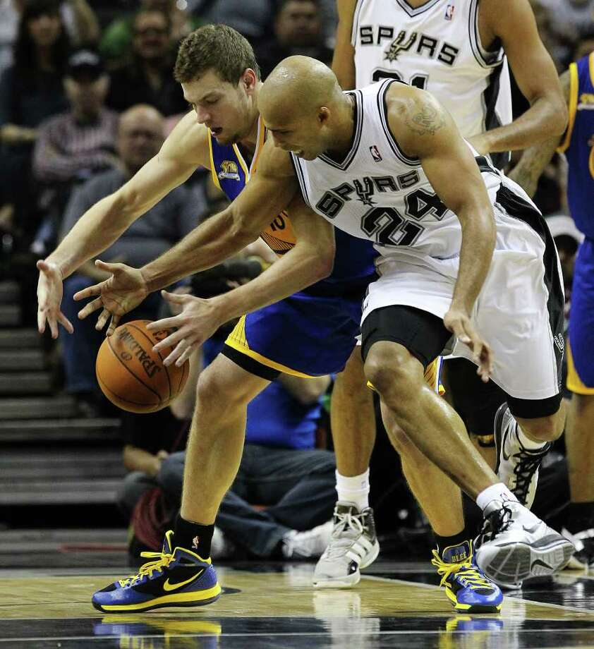 Spurs' Richard Jefferson (24) goes for a steal against the Golden State Warriors' David Lee (10) in the second half at the AT&T Center on Wednesday, Jan. 4, 2012. Spurs won 101-95. Kin Man Hui/kmhui@express-news.net Photo: KIN MAN HUI, Express-News / SAN ANTONIO EXPRESS-NEWS