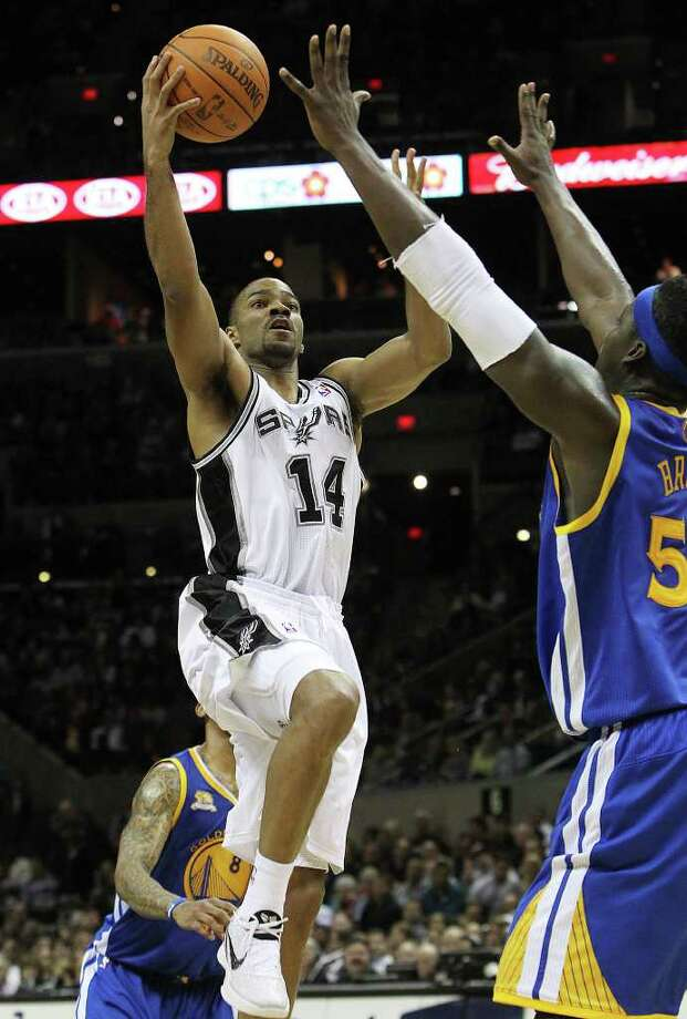 Spurs' Gary Neal (14) goes up for shot against the Golden State Warriors' Kwame Brown in the second half at the AT&T Center on Wednesday, Jan. 4, 2012. Spurs won 101-95. Kin Man Hui/kmhui@express-news.net Photo: KIN MAN HUI, Express-News / SAN ANTONIO EXPRESS-NEWS