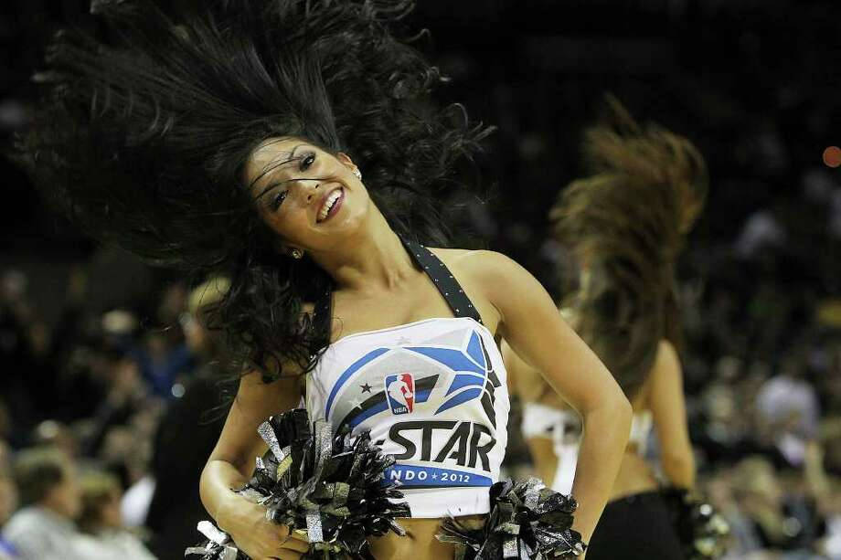 A Spurs Silver Dancer performs during a pause in the game against the Golden State Warriors in the second half at the AT&T Center on Wednesday, Jan. 4, 2012. Spurs won 101-95. Kin Man Hui/kmhui@express-news.net Photo: KIN MAN HUI, Express-News / SAN ANTONIO EXPRESS-NEWS