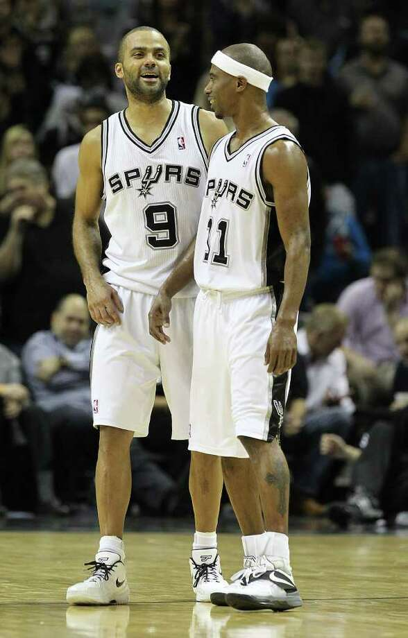 Spurs' Tony Parker and T.J. Ford share a laugh duringa pause in the action against the Golden State Warriors in the second half at the AT&T Center on Wednesday, Jan. 4, 2012. Spurs won 101-95. Kin Man Hui/kmhui@express-news.net Photo: KIN MAN HUI, Express-News / SAN ANTONIO EXPRESS-NEWS
