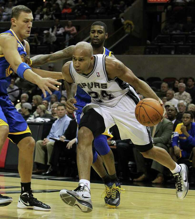 Spurs' Richard Jefferson (24) drives the baseline against the Golden State Warriors' Andris Biedrins (15) in the second half at the AT&T Center on Wednesday, Jan. 4, 2012. Spurs won 101-95. Kin Man Hui/kmhui@express-news.net Photo: KIN MAN HUI, Express-News / SAN ANTONIO EXPRESS-NEWS
