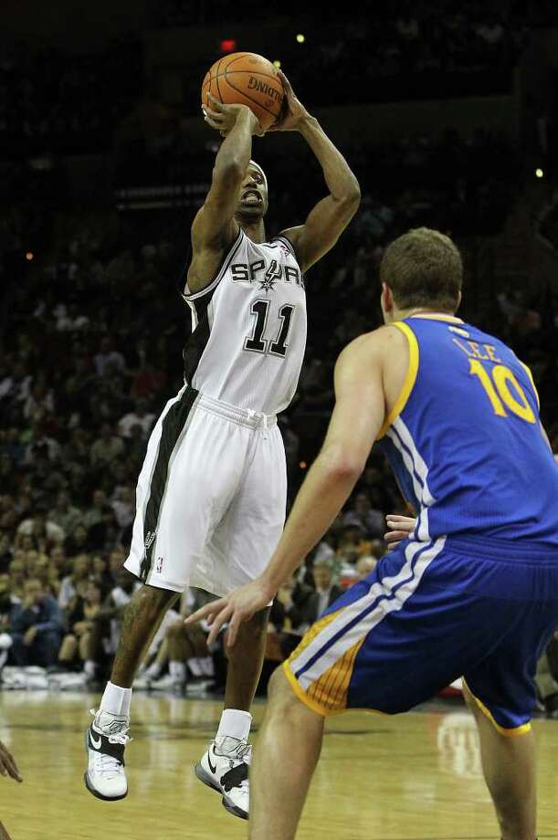 Spurs' T.J. Ford (11) shoots over the Golden State Warriors' David Lee (10) in the second half at the AT&T Center on Wednesday, Jan. 4, 2012. Spurs won 101-95. Kin Man Hui/kmhui@express-news.net Photo: KIN MAN HUI, Express-News / SAN ANTONIO EXPRESS-NEWS