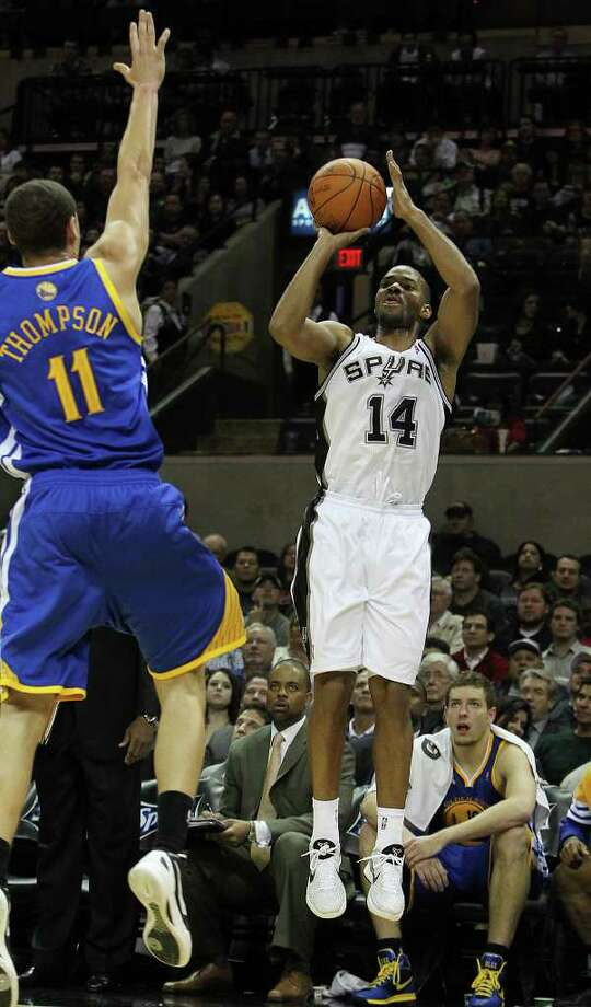 Spurs' Gary Neal (14) launches a three-pointer against the Golden State Warriors' Klay Thompson (11) in the second half at the AT&T Center on Wednesday, Jan. 4, 2012. Spurs won 101-95. Kin Man Hui/kmhui@express-news.net Photo: KIN MAN HUI, Express-News / SAN ANTONIO EXPRESS-NEWS