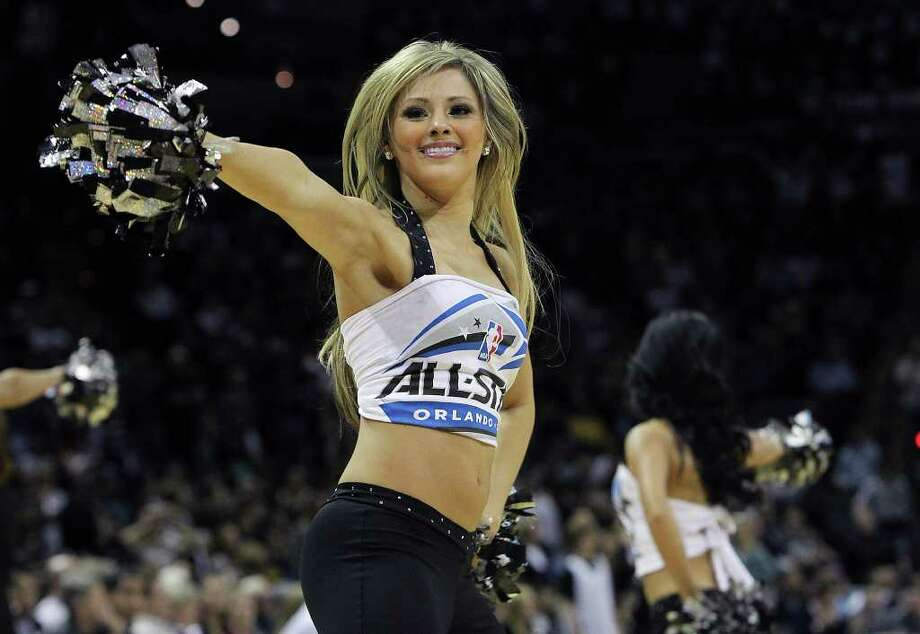 A Spurs Silver Dancer performs during a pause in the game against the Golden State Warriors in the second half at the AT&T Center on Wednesday, Jan. 4, 2012. Spurs won 101-95. Kin Man Hui/kmhui@express-news.net Photo: KIN MAN HUI, ~ / SAN ANTONIO EXPRESS-NEWS