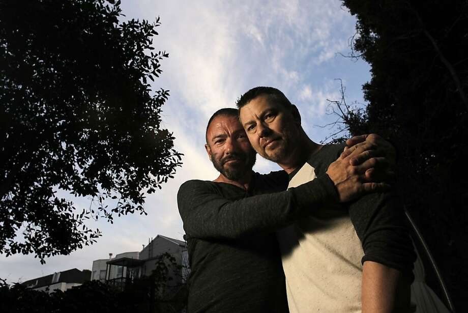Bradford Wells, (left) and Anthony John Makk at their San Francisco, Ca. home, on Wednesday Jan. 4 2012. Wells and Makk, are a married gay couple that have lived most of their 19 years of relationship in San Francisco's Castro district, today won a two year stay against the threat of deportation, thanks to the personal intervention of the representative Nancy Pelosi, D-San Francisco. Makk is a citizen of Australia married to Wells, a U.S. citizen who suffers from AIDS-related illness. Makk is his primary caregiver. Photo: Michael Macor, The Chronicle