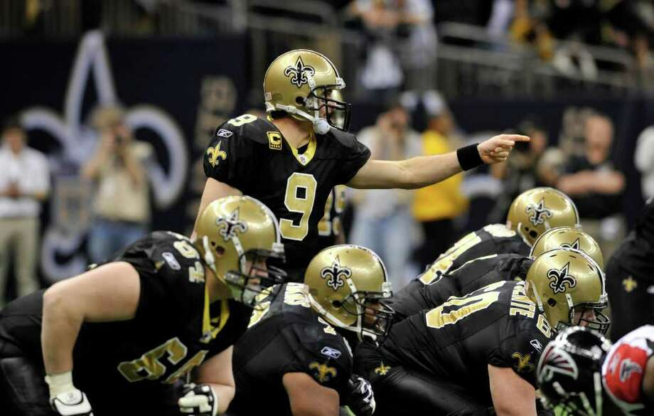 New Orleans Saints quarterback Drew Brees (9) calls a play from the line of scrimmage  in the fourth quarter of an NFL football game against the Atlanta Falcons in New Orleans, Monday, Dec. 26, 2011. (AP Photo/Bill Feig)For a look at the NFL's top five free agents at each position and the teams they played for last season, browse through the slideshow. Photo: Bill Feig / FR44286 AP