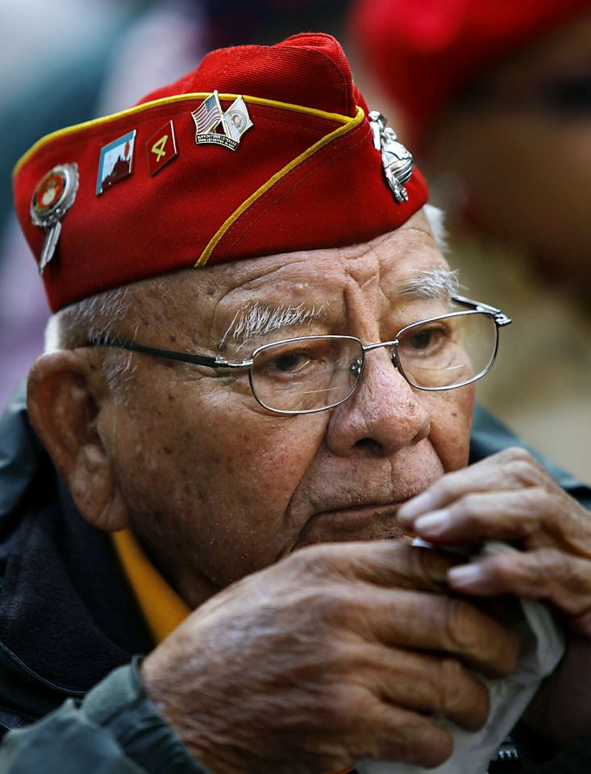 FILE - In this Nov. 11, 2011 photo, Keith Little, 87, from Winter Rock, Az., a veteran Navajo CodeTalker with the U.S. Marine Corp 4th Marine Division 25th Regiment between 1939- 1945, listens during ceremonies for the New York City Veterans Day Parade. The Navajo Code Talkers Association says Little died Tuesday, Jan. 3, 2012 at a Fort Defiance, Ariz., hospital. He was 87. (AP Photo/Bebeto Matthews)