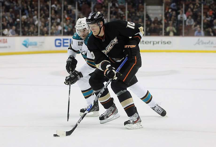 ANAHEIM, CA - JANUARY 04:  Corey Perry #10 of the Anaheim Ducks is pursued by Patrick Marleau #12 of the San Jose Sharks in the first period at Honda Center on January 4, 2012 in Anaheim, California.  (Photo by Jeff Gross/Getty Images) Photo: Jeff Gross, Getty Images