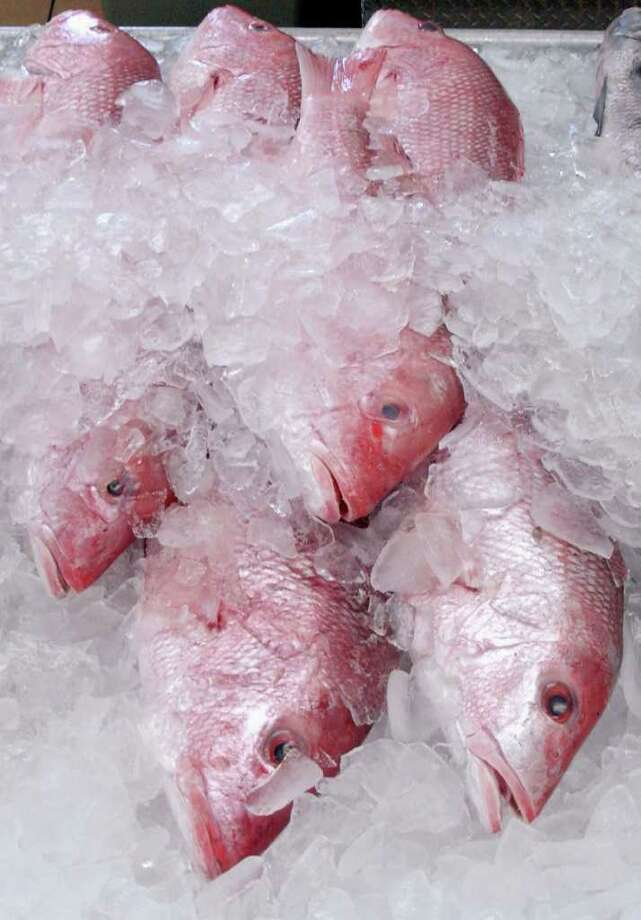 ** ADVANCE FOR WEEKEND OF DEC. 10-11 ** A few whole red snapper are shown for sale Joe Patti's Seafood Market in Pensacola, Fla., Wednesday Nov. 30, 2005. The tasty fish once so plentiful in these gulf waters have long since been depleted by heavy fishing, shrimp trawling and environmental pressures. Photo: MARI DARR~WELCH, AP / AP