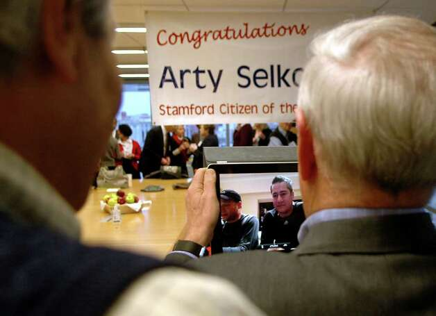 Arty Selkowitz was named Stamford's Citizen of the Year for 2011 at Purdue Pharma in Stamford Conn. on Thursday, Jan. 5, 2012. The sons of Arty and Betsey Selkowitz, Jed and Adam, joined the party from Los Angelos,California with the use of facetime technology. Photo: Cathy Zuraw / Stamford Advocate