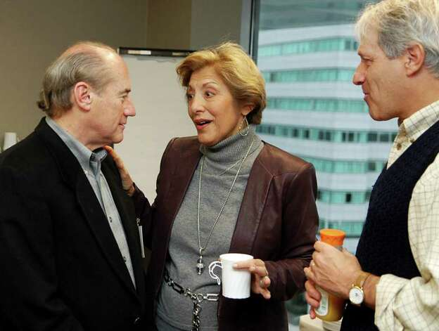 Arty Selkowitz talks with Sandy Goldstein and Rick Redniss at a reception to honor Selkowitz being named Stamford's Citizen of the Year for 2011 at Purdue Pharma in Stamford Conn. on Thursday, Jan. 5, 2012. Photo: Cathy Zuraw / Stamford Advocate