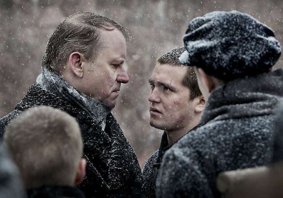 "Erling (Benjamin Helstad) and Bestyreren (Stellan SkarsgŒrd) appear in a scene from, ""King of Devil's Island."" Photo: Film Movement"
