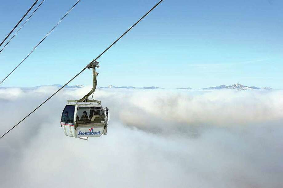 A gondola car rises above the clouds blanketing the floor in the Yampa Valley near Steamboat Springs, Colo. Photo: John F.Russell / John F. Russell