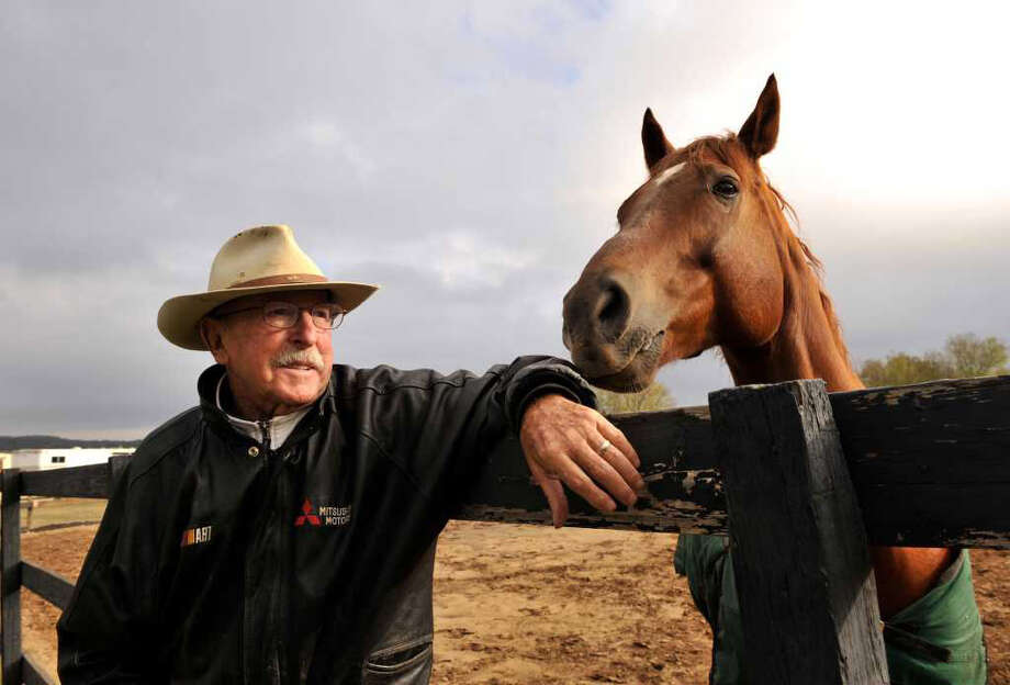 Col. John Russell of the Russell Equestrian Center has participated in and coached Olympic pentathalon athletes since 1948. He will be inducted into the San Antonio Sports Hall of Fame. Photo: Photo By Robin Jerstad/Special To The Express-News
