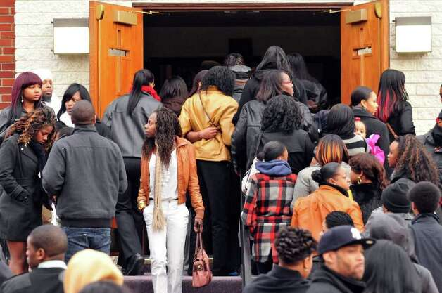 Mourners leave the  Metropolitan New Testament Mission Baptist Church in Albany following the funeral services for Nah-Cream Moore on Thursday, Jan.5, 2012. ( Michael P. Farrell/Times Union) Photo: Michael P. Farrell