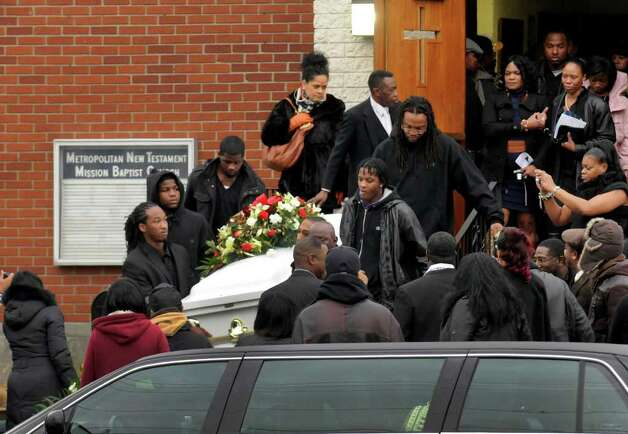 Mourners leave the  Metropolitain New Testament Mission Baptist Curch following the funeral services for Nah-Cream Moore in Albany,NY Thursday, Jan.5, 2012. ( Michael P. Farrell/Times Union) Photo: Michael P. Farrell