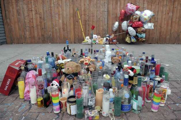 A street memorial has been set up, seen here on Thursday morning, Jan. 5, 2012, on South Pearl St. near the spot where Nah-Cream Moore, 19, of Troy was shot by Albany Police last week.  (Paul Buckowski / Times Union) Photo: Paul Buckowski