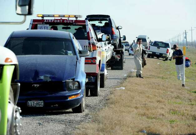 More than 50 people were injured early Thursday morning on Texas 73 when smoke from a marsh fire caused a 54-car-pileup. Four of the injured are said to be in critical condition. No fatalities were reported from the accident. Photo taken Thursday, January 5, 2012 Guiseppe Barranco/The Enterprise Photo: Guiseppe Barranco, STAFF PHOTOGRAPHER / The Beaumont Enterprise