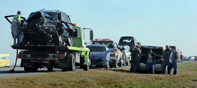 Wrecked cars and a fleet of tow trucks lined Texas 73 Thursday morning after an accident involving more than 50 cars closed down the road until around noon. Photo taken Thursday, January 5, 2012 Guiseppe Barranco/The Enterprise Photo: Guiseppe Barranco, STAFF PHOTOGRAPHER / The Beaumont Enterprise