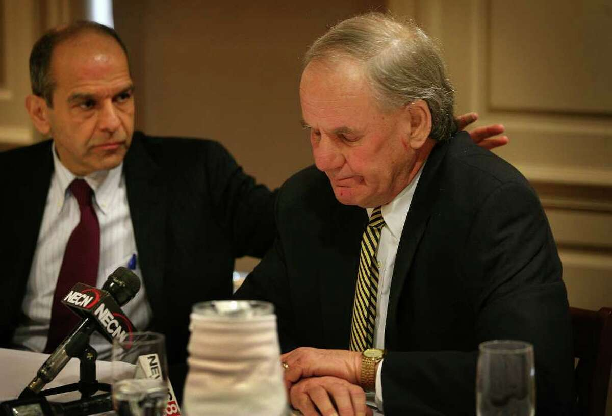 Attorney Mitchel Garabedian, left, comforts Paul Kendrick as he pauses to compose himself while discussing Haitian sexual abuse cases in a press conference at the Delmar Hotel in Southport on Thursday, January 5, 2012. Garabedian announced lawsuits of $20 million dollars for each count by Haitian victims of Douglas Perlitz.