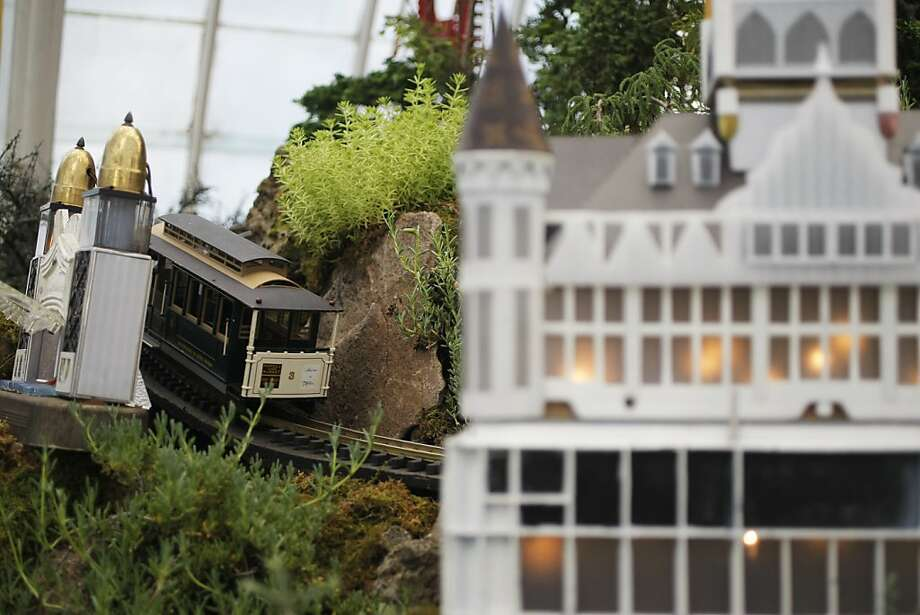A cable car zips by in the Playland-at-the-Beach themed diorama at the Conservatory of Flowers in San Francisco, Calif., on Wednesday, Dec. 6, 2011. Photo: Dylan Entelis, The Chronicle