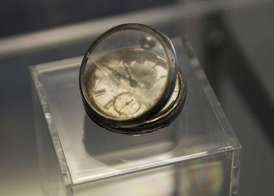 A pocket watch from the RMS Titanic is on display during a news conference by Guernsey's Auction House January 5, 2012 aboard the Intrepid Sea, Air & Space Museum in New York. Guernsey's announced the historic auction of the complete collection of artifacts recovered from the wreck site of RMS Titanic. Photo: Don Emmert, AFP/Getty Images