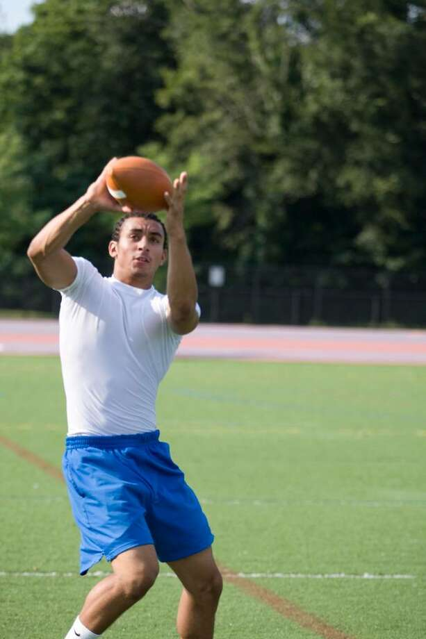 Danbury High receiver Damian Winters grabs a pass during practice. Photo: Barry Horn / The News-Times