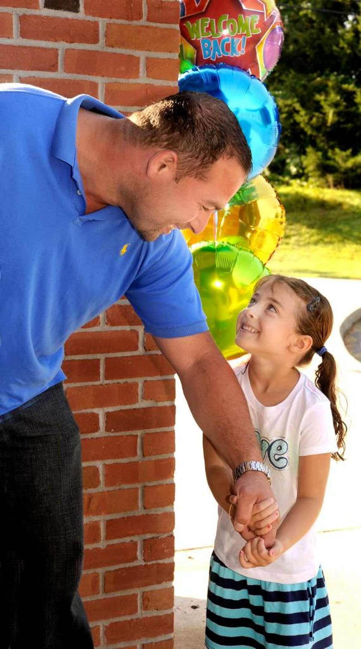 Dan Roe gives a word of encouragement to Emma, his 5 year old daughter at the enterance to the Frank A. Berry school in Bethel on her first day, Aug.25.2009.