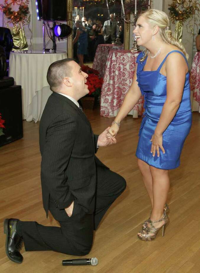 Troy, NY - Decmebr 31, 2011 - (Photo by Joe Putrock/Special to the Times Union) - Justin Gershon(left) dropped to one knee and reached for a diamond ring while proposing to Amy Galka during the St. Peter's Hospital Foundation Last NIght Gala 2011. Photo: Joe Putrock / Joe Putrock