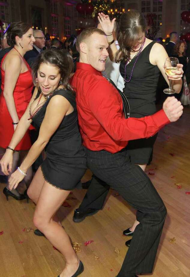 Troy, NY - Decmebr 31, 2011 - (Photo by Joe Putrock/Special to the Times Union) - Chris Hosley(center) dances with Tabatha Chastana(left) and Stef Martino(right) during the St. Peter's Hospital Foundation Last NIght Gala 2011. Photo: Joe Putrock / Joe Putrock