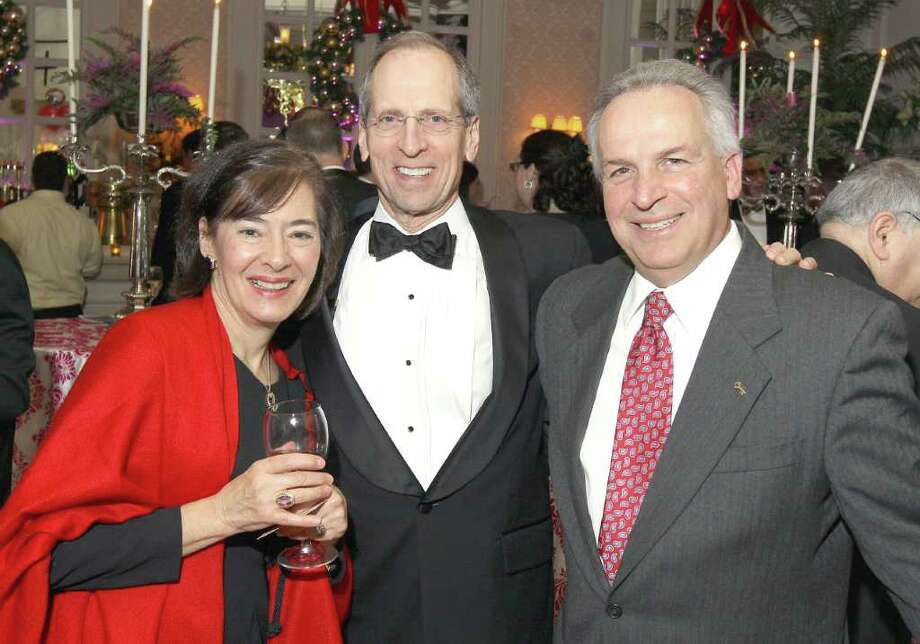 Troy, NY - Decmebr 31, 2011 - (Photo by Joe Putrock/Special to the Times Union) - St. Peter's Hospital President and CEO Steven Boyle(center) poses with his wife Rosemarie(left) and Key Bank Rochester District President James Carriero(right) during the St. Peter's Hospital Foundation Last NIght Gala 2011. Photo: Joe Putrock / Joe Putrock