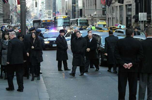 Family members arrive at the church for the funeral for the three Badger sisters, Lilian, Sarah and Grace, takes place at St. Thomas Church Fifth Avenue in Manhattan, N.Y., on Thursday, January 5, 2012. The sisters were killed along with their grandparents, Lomer and Pauline Johnson, when their mother's Shippan home burned down on Christmas Day. Photo: Keelin Daly / Stamford Advocate
