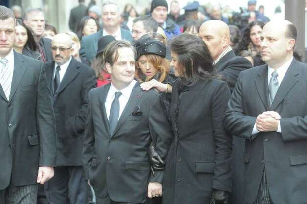 Matthew and Madonna Badger at the funeral for their three daughters, Lilian, Sarah and Grace, at St. Thomas Church Fifth Avenue in Manhattan, N.Y., on Thursday, January 5, 2012. The sisters were killed along with their grandparents, Lomer and Pauline Johnson, when their mother's Shippan home burned down on Christmas Day. Photo: Keelin Daly / Stamford Advocate