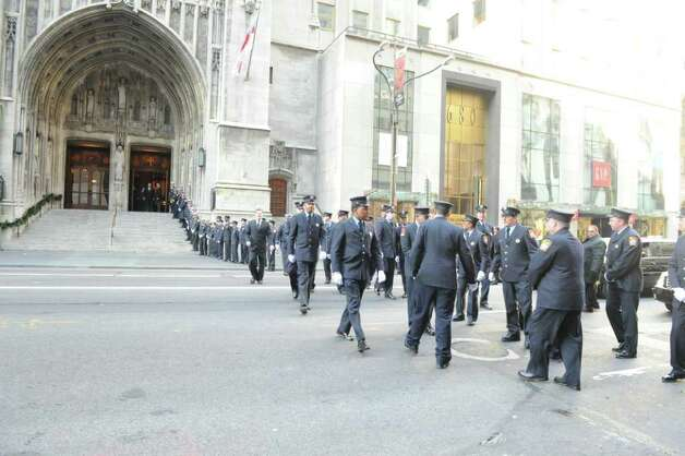 Stamford firefighters exit the church after the funeral for the three Badger sisters, Lilian, Sarah and Grace, at St. Thomas Church Fifth Avenue in Manhattan, N.Y., on Thursday, January 5, 2012. The sisters were killed along with their grandparents, Lomer and Pauline Johnson, when their mother's Shippan home burned down on Christmas Day. Photo: Keelin Daly / Stamford Advocate
