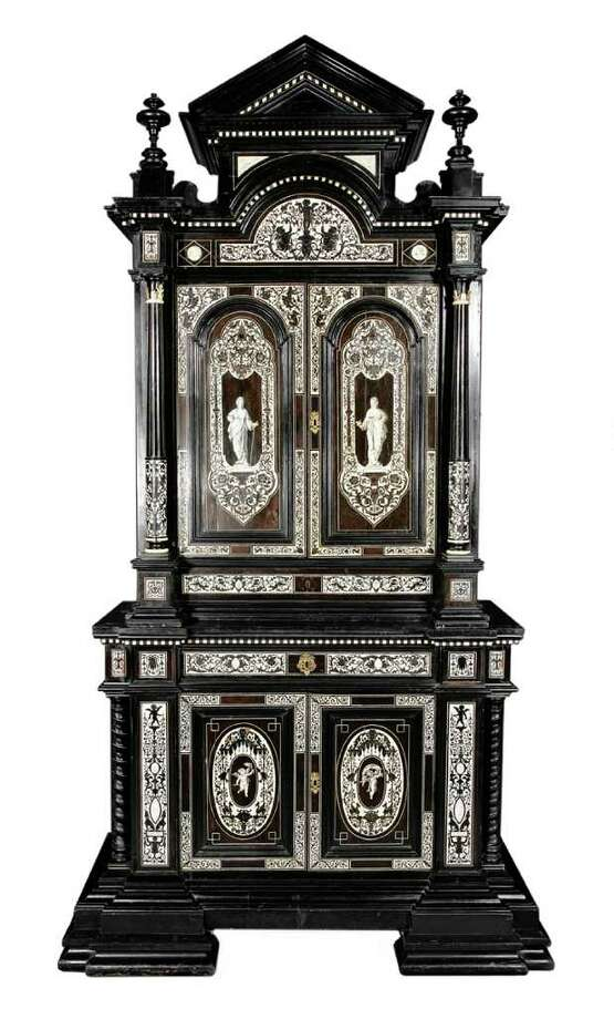 This Renaissance Revival cabinet, made in the mid-19th century, couldnít be made today because of rules about endangered species. And most homes are not built with high enough ceilings for a cabinet thatís more than 9 feet tall. This walnut, ebony and ivory cabinet sold for $7,200 at a Neal Auction Co. sale in New Orleans. Photo: Contributed Photo / The News-Times Contributed