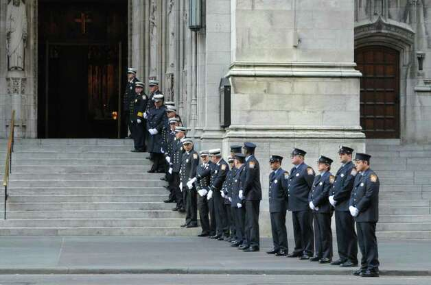 Stamford firefighters in formation outside the church after the funeral for the three Badger sisters, Lilian, Sarah and Grace, at St. Thomas Church Fifth Avenue in Manhattan, N.Y., on Thursday, January 5, 2012. The sisters were killed along with their grandparents, Lomer and Pauline Johnson, when their mother's Shippan home burned down on Christmas Day. Photo: Keelin Daly / Stamford Advocate
