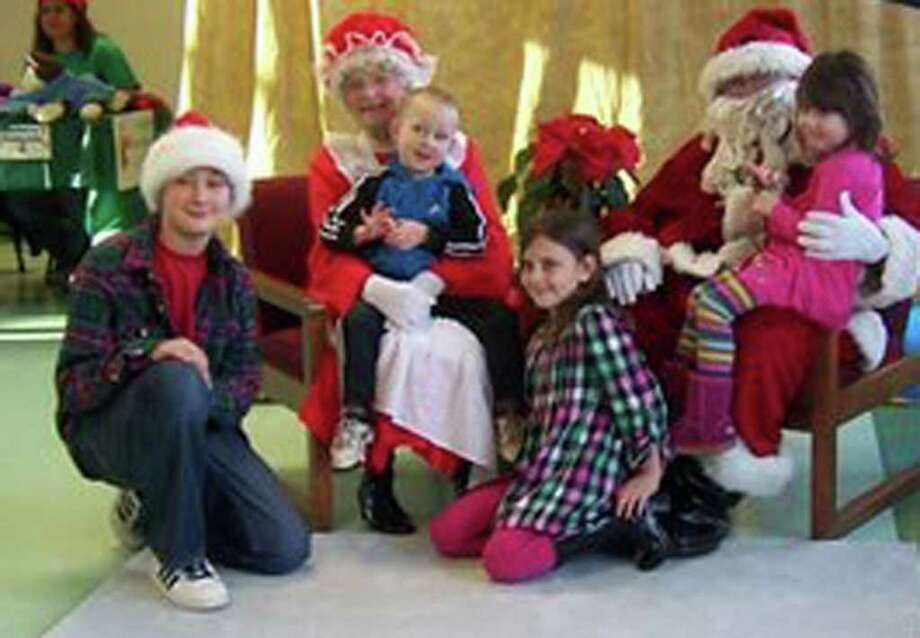 Newtown Park and Bark volunteers raised $500 by hosting an event called Breakfast with Santa on Dec. 10, 2011. Families posed with Santa Claus and purchased their photos at $10 each. Photo courtesy of Roseann Reggiano, the Assistant Director of Recreation. Photo: Contributed Photo